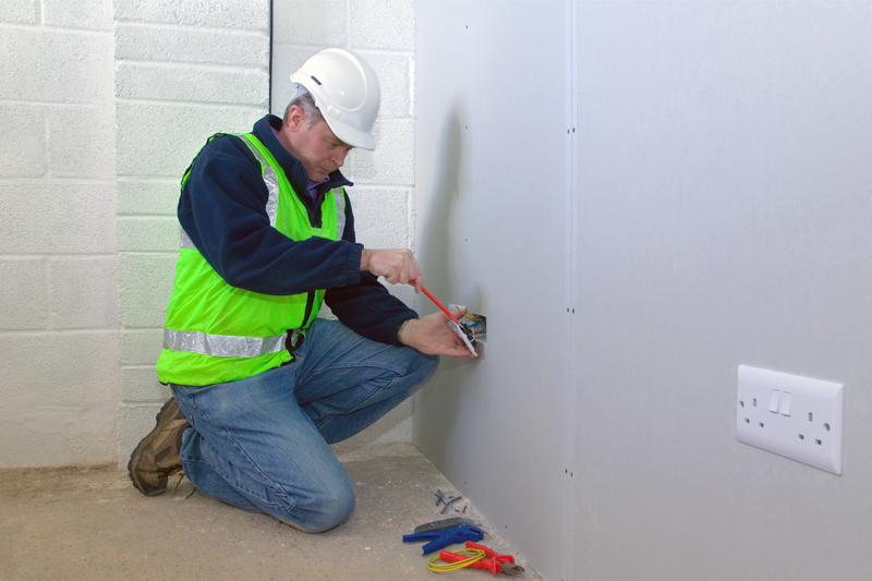 Man working on a plug socket